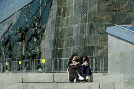 A young couple sit near the wall of Ilyich of the monument to the Conquerors of Space.The Cosmonautics Museum is one of the largest scientific and historical museums in the world. The history of the museum began in the second half of the 20th century, when in 1964 a monument to the Conquerors of Space appeared on the map of Moscow.The titanium rocket at VDNKh has become a symbol of a qualitative technological leap of its time. The launch of the first artificial Earth satellite, the first living beings and the first man in space became the starting point in world cosmonautics.On the 60th anniversary of the first manned flight into space, tourists came to visit the Museum of Cosmonautics to learn more about the first cosmonaut, the Soviet test pilot Yuri Gagarin.