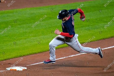 Stock Photo of Boston Red Sox's Alex Verdugo runs before scoring on a single by Christian Vazquez during the tenth inning of a baseball game against the Baltimore Orioles, in Baltimore. The Red Sox won 6-4 in ten innings