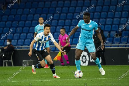 (210412) - CORNELLA, April 12, 2021 (Xinhua) - RCD Espanyol's Wu Lei (L) Lives with Leganes' Kenneth Omeruo during a Spanish second division league football match between RCD Espanyol and CD Leganes in Cornella, Spain, April 11, 202 1.