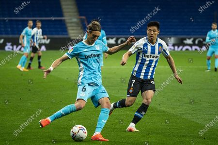 (210412) - CORNELLA, April 12, 2021 (Xinhua) - RCD Espanyol's Wu Lei (R) lives with Leganes' Sergio Gonzalez during a Spanish second division league football match between RCD Espanyol and CD Leganes in Cornella, Spain, April 11, 202 1.