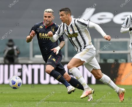(210412) - TURIN, April 12, 2021 (Xinhua) - FC Juventus' Cristiano Ronaldo (R) lives with Genoa's Valon Behrami during a serie A football match between FC Juventus and Genoa in Turin, Italy, April 11, 2021.