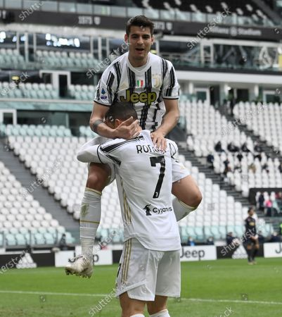 Stock Picture of (210412) - TURIN, April 12, 2021 (Xinhua) - FC Juventus' Alvaro Morata (top) celebrates his goal with teammate Cristiano Ronaldo during a serie A football match between FC Juventus and Genoa in Turin, Italy, April 11, 2021.