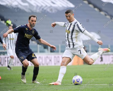 Stock Image of (210412) - TURIN, April 12, 2021 (Xinhua) - FC Juventus' Cristiano Ronaldo (R) competes during a series A football match between FC Juventus and Genoa in Turin, Italy, April 11, 2021.