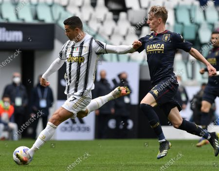 (210412) - TURIN, April 12, 2021 (Xinhua) - FC Juventus' Cristiano Ronaldo (L) lives with Genoa's Nicolo Rovella during a serie A football match between FC Juventus and Genoa in Turin, Italy, April 11, 2021.