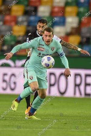 Andrea Beloitti of Torino fight for the dal against Udinese's Roberto Pereyra