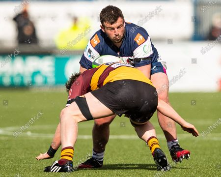 Stock Image of Alex Gibson of Coventry Rugby is tackled