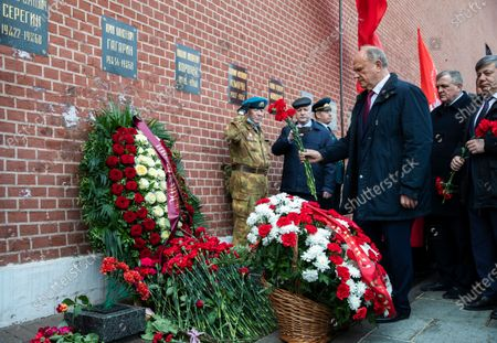 Russian Communist Party leader Gennady Zyuganov lays flowers at the grave of Yuri Gagarin, the first person who flew to space, in the Kremlin wall in Moscow, Russia, . Russia on Monday marks the 60th anniversary of Gagarin's pioneering mission on April 12 1961, the first human flight to orbit that opened the space era