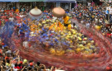 A picture taken with slow shutter speed shows Nepalese devotees of the Newar community, an ancient community of Kathmandu, wearing Red, Blue and Yellow caps as they parade to celebrate the chariot festival, locally known as a 'Daya Lyagu' at Aason in Kathmandu, Nepal, 12 April 2021. The festival marks the victory of the Goddess Durga over a demon who - according to the legend - used to kill and devour local children in ancient days.
