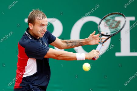 Daniel Evans of Britain in action during his first round match against Dusan Lajovic of Serbia at the Monte-Carlo Rolex Masters tournament in Roquebrune Cap Martin, France, 12 April 2021.