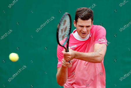 Stock Photo of Hubert Hurkacz of Poland in action during his first round match against Thomas Fabbiano of Italy at the Monte-Carlo Rolex Masters tournament in Roquebrune Cap Martin, France, 12 April 2021.