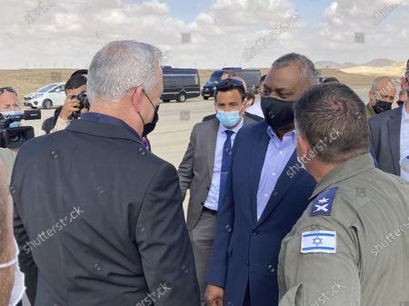 Defense Secretary Lloyd Austin, second from right, is greeted by Israeli Defense Minister Benny Gantz, left, at Nevatim Israeli Air Force Base in in Israel