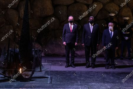 Secretary of Defense, General Lloyd James Austin III, center, with Israeli Defense Minister Benny Gantz, (left) and Ronen Plot, the acting chairman of Yad Vashem, during a memorial ceremony in the Hall of Remembrance during a visit to Yad Vashem