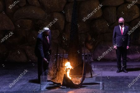 Secretary of Defense, General Lloyd James Austin III, left, rekindles the eternal flame, with Israeli Defense Minister Benny Gantz, during a memorial ceremony in the Hall of Remembrance during at Yad Vashem