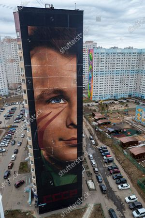 The 60 meters high effigy of USSR cosmonaut Yuri Gagarin created by graffiti artist from Italy IJorit Agoch in Odintsovo, Moscow region, Russia, 12 April 2021. The picture is painted on a nineteen-storey building in a residential area of the city of Odintsovo. Russia marks the 60th anniversary of the first human spaceflight on April 12.