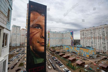 The 60 meters high effigy of first USSR cosmonaut Yuri Gagarin created by graffiti artist from Italy IJorit Agoch in Odintsovo, Moscow region, Russia, 12 April 2021. The picture is painted on a nineteen-storey building in a residential area of the city of Odintsovo. Russia marks the 60th anniversary of the first human spaceflight on April 12.