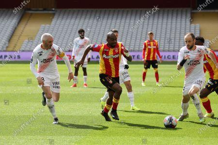 Duel Fabien Lemoine 18 and Jerome Hergault 14 FC Lorient and Gael Kakuta 10 RC Lens