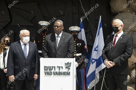 US Secretary of Defense General Lloyd Austin with Israeli Defense Minister Benny Gantz (R) and  Ronen Plot, as he makes a statement following a memorial ceremony in the Hall of Remembrance during his visit to Yad Vashem, Jerusalem, Israel, 12 April 2021.