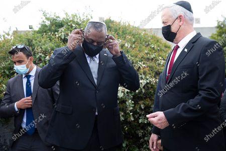 US Secretary of Defense, General Lloyd Austin removes his protective mask as he stands with Israeli Defense Minister Benny Gantz (R) at the end of his visit to Yad Vashem, Jerusalem, Israel, 12 April 2021.