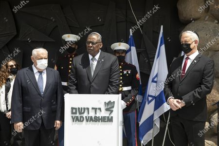 Secretary of Defense, General Lloyd James Austin III, center left, stands with Israeli Defense Minister Benny Gantz, right, as he makes a statement following a memorial ceremony in the Hall of Remembrance during his visit to Yad Vashem, in Jerusalem