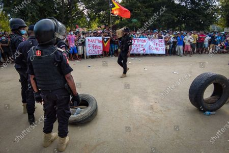 A heavy police deployment has been concentrated since late morning around the Vera Cruz isolation where a standoff remains over the removal of the body of a man who died of COVID-19, in Dili, Timor-Leste, 12 April 2021. Timorese historical leader Xanana Gusmao remains adamant and is still sitting under a green awning outside the center, located on Rumbia crossing, refusing to leave the site, in solidarity with the family of the deceased.