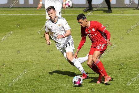 Robin Knoche #31 (1. FC Union Berlin) and Jamal Musiala #42 (FC Bayern Munich)