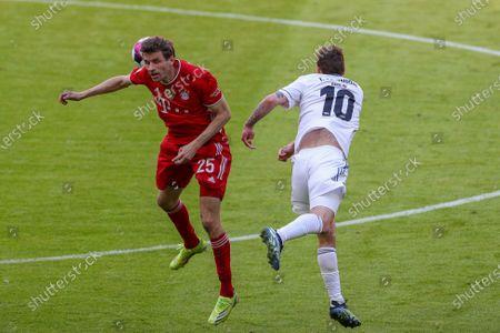 Thomas Müller #25 (FC Bayern Munich) and Max Kruse #10 (1. FC Union Berlin)