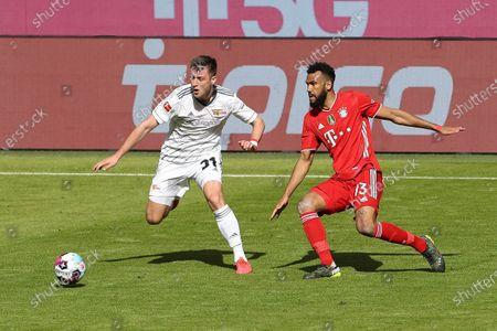 Robin Knoche #31 (1st FC Union Berlin) and Eric Maxim Choupo-Moting #13 (FC Bayern Munich)