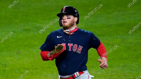Boston Red Sox's Alex Verdugo scores on a single by Christian Vazquez during the tenth inning of a baseball game against the Baltimore Orioles, in Baltimore. The Red Sox won 6-4 in ten innings
