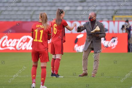 Tine De Caigny (6) of Belgium pictured receiving her Golden Shoe from Roberto Martinez during a friendly female soccer game between the national teams of Belgium, called the Red Flames and The Republic of Ireland