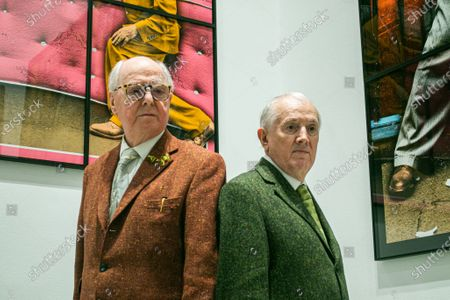 Stock Picture of A preview of 'NEW NORMAL PICTURES', a solo exhibition at the White Cube Gallery, Park Lane London, by Gilbert & George (pictured) bringing together 26 new pictures described by the artists as 'celebratory, crazed and super-modern'. Continuing their 'Pilgrim's Progress' through east London, the artists capture the mood of the moment and appear as zonked figures amongst disorientating cityscapes
