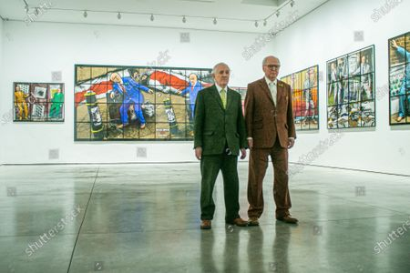 Stock Image of A preview of 'NEW NORMAL PICTURES', a solo exhibition at the White Cube Gallery, Park Lane London, by Gilbert & George (pictured) bringing together 26 new pictures described by the artists as 'celebratory, crazed and super-modern'. Continuing their 'Pilgrim's Progress' through east London, the artists capture the mood of the moment and appear as zonked figures amongst disorientating cityscapes