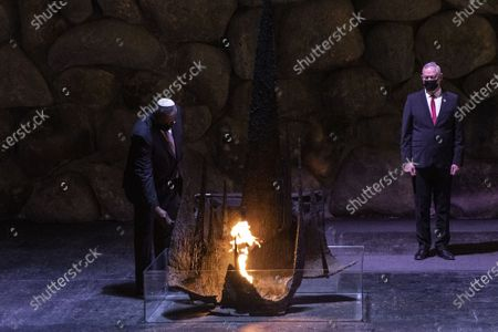 Stock Photo of U.S. Secretary of Defense General Lloyd Austin rekindles the eternal flame during a memorial ceremony in the Hall of Remembrance during his visit to Yad Vashem on Monday, April 12, 2021. Israeli Defense Minister Benny Gantz, right,accompanied him on the visit. Pool Photo by Heidi Levine/UPI