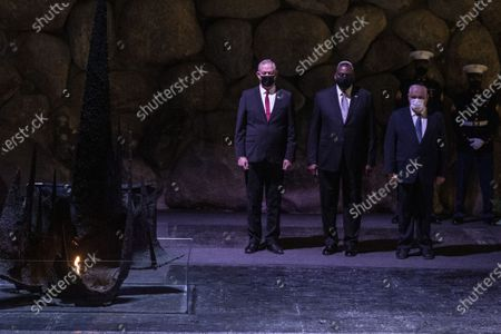 U.S. Secretary of Defense General Lloyd Austin with Israeli Defense Minister Benny Gantz (left) and Ronen Plot, the acting chairman of Yad Vashem, during a memorial ceremony in the Hall of Remembrance during his visit to Yad Vashem