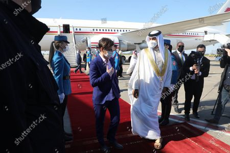 """Stock Picture of The Prime Minister of Serbia, Ana Brnabic, welcomed Sheik Nasser bin Hamad Al Khalifa today at the Belgrade """"Nikola Tesla"""" airport."""