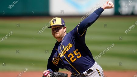Milwaukee Brewers starting pitcher Brett Anderson throws during the first inning of a baseball game against the St. Louis Cardinals, in St. Louis