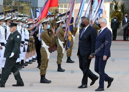 (210412) - TEL AVIV, April 12, 2021 (Xinhua) - U.S. Defense Secretary Lloyd Austin (2nd R, front) and Israeli Defense Minister Benny Gantz (1st R, front) are seen at a ceremony at the Kirya military base in Tel Aviv, Israel on April 11, 202 1. U.S. Defense Secretary Lloyd Austin started a two-day visit to Israel on Sunday, in the first official visit by a U.S. official since President Joe Biden's inauguration in January.