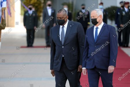 (210412) - TEL AVIV, April 12, 2021 (Xinhua) - U.S. Defense Secretary Lloyd Austin (L) and Israeli Defense Minister Benny Gantz are seen at a ceremony at the Kirya military base in Tel Aviv, Israel on April 11, 2021. U.S. Defense Secretary Lloyd Austin started a two-day visit to Israel on Sunday, in the first official visit by a U.S. official since President Joe Biden's inauguration in January.