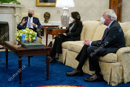 President Joe Biden speaks during a meeting with lawmakers to discuss the American Jobs Plan in the Oval Office of the White House, in Washington. Seated alongside Biden are Sen. Maria Cantwell, D-Wash., and Sen. Roger Wicker, R-Miss