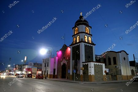 Nuestra Senora de Guadalupe church along Francisco I Madero at the central square on Wednesday, March 24, 2021 in Sabinas, Coahuila. The town of Sabinas and the surrounding areas economy is supported by the coal mining industry. Mexico once embraced renewable energies. Now President Andres Manuel Lopez Obrador is doubling down on dirty fossil fuels such as coal. (Gary Coronado / Los Angeles Times)