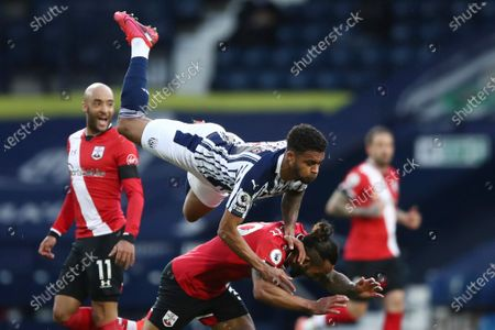 West Bromwich Albion's Darnell Furlong, centre top and Southampton's Theo Walcott collide during an English Premier League soccer match between West Bromwich Albion and Southampton at The Hawthorns in West Bromwich, England