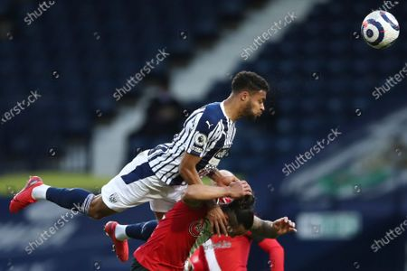 West Bromwich Albion's Darnell Furlong, centre top jumps above Southampton's Theo Walcott during an English Premier League soccer match between West Bromwich Albion and Southampton at The Hawthorns in West Bromwich, England