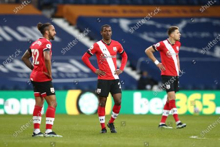 Ibrahima Diallo (C) and Theo Walcott (L) of Southampton react during the English Premier League match between West Bromwich Albion and Southampton in West Bromwich, Britain, 12 April 2021.