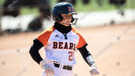 Mercer's Sophie Sumner (27) runs to first base during an NCAA softball game, in Cary, N.C