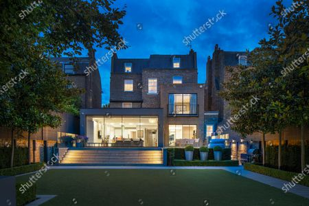 Stock Picture of A luxurious home that has gone on the market for a whopping £19m will appeal to wealthy sports fanatics.  The Victorian property in London's St Johns Wood comes with a swimming pool, gym and spa and a mini football pitch in the garden.  The designer house is on a sought-after road that has been home to Bond actor Honor Blackman and author Thomas Hardy.