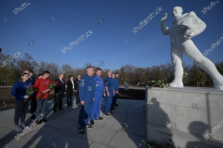 Russian President Vladimir Putin (C) attends a flowers laying ceremony at the park of Space Explorers museum complex at the landing site of Yuri Gagarin,  outside the Novaya Ternovka village, about 30 km from the city of Engels, on Cosmonautics Day in Saratov region, Russia, 12 April 2021. Russia marks 60th anniversary of the first human flight into space. On 12 April 1961, Soviet cosmonaut Yuri Gagarin performed a space flight aboard the Vostok-1 spacecraft, orbiting Earth in 108 minutes and landing safely.