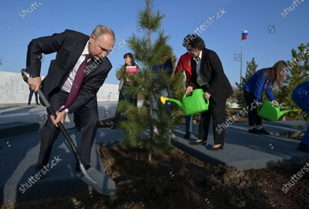 Stock Picture of Russian President Vladimir Putin (L) plants a pine tree at the park of Space Explorers museum complex at the landing site of Yuri Gagarin, outside the Novaya Ternovka village, about 30 km from the city of Engels, on Cosmonautics Day in Saratov region, Russia, 12 April 2021. Russia marks 60th anniversary of the first human flight into space. On 12 April 1961, Soviet cosmonaut Yuri Gagarin performed a space flight aboard the Vostok-1 spacecraft, orbiting Earth in 108 minutes and landing safely.