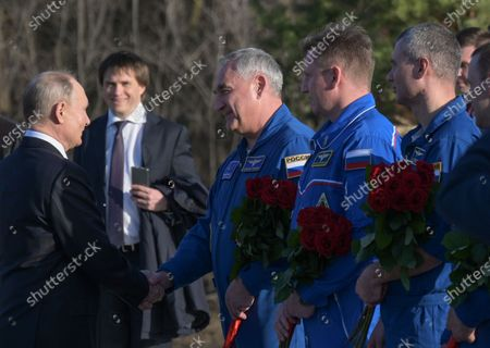 Stock Image of Russian President Vladimir Putin (L) welcomes members of the Roscosmos cosmonaut squad at the park of Space Explorers museum complex at the landing site of Yuri Gagarin, outside the Novaya Ternovka village, about 30 km from the city of Engels, on Cosmonautics Day in Saratov region, Russia, 12 April 2021. Russia marks 60th anniversary of the first human flight into space. On 12 April 1961, Soviet cosmonaut Yuri Gagarin performed a space flight aboard the Vostok-1 spacecraft, orbiting Earth in 108 minutes and landing safely.
