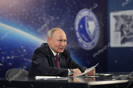 Stock Photo of Russian President Vladimir Putin holds a conference on the development of the space industry, in the city of Engels, on Cosmonautics Day in Saratov region, Russia, 12 April 2021. Russia marks 60th anniversary of the first human flight into space. On 12 April 1961, Soviet cosmonaut Yuri Gagarin performed a space flight aboard the Vostok-1 spacecraft, orbiting Earth in 108 minutes and landing safely.