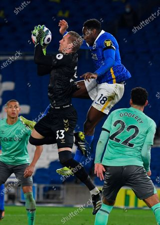Everton's goalkeeper Robin Olsen (L) makes a save in front of Brighton's Danny Welbeck (R) during the English Premier League match between Brighton & Hove Albion and Everton in Brighton, Britain, 12 April 2021.