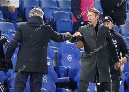 Everton's manager Carlo Ancelotti (L) reacts with Brighton's head coach Graham Potter (R) at the end of the English Premier League match between Brighton & Hove Albion and Everton in Brighton, Britain, 12 April 2021.